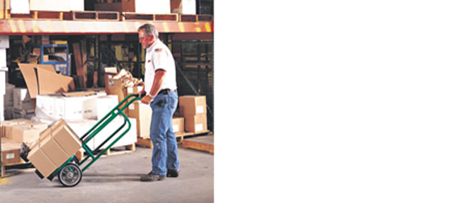 man with handtruck lifting boxes
